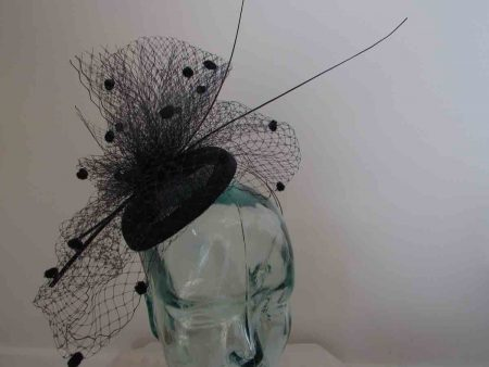 Pill box fascinator with birdcage veil in navy