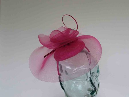 Looped netted fascinator in pink magenta