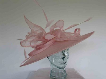Oval hatinator with sinamay bow in candy pink
