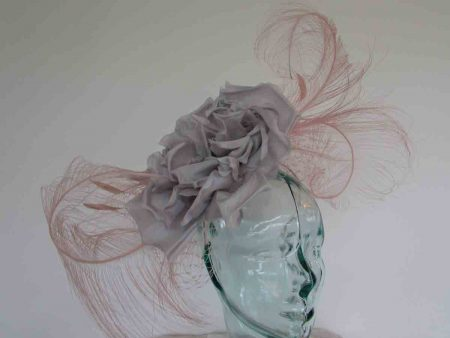 Large feather fascinator with rose in rose pink and silver