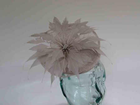 Pillbox fascinator with flower in almond silver