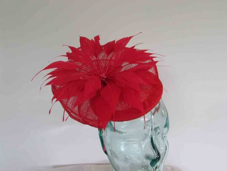 Pillbox fascinator with flower in tulip red