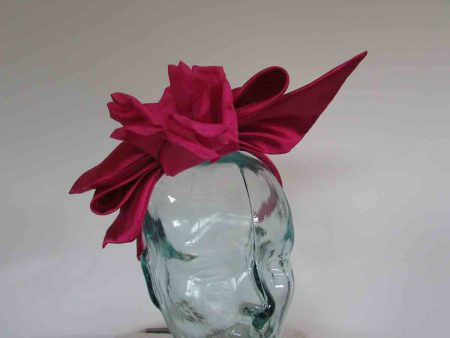 Bow fascinator with flower in fuschia