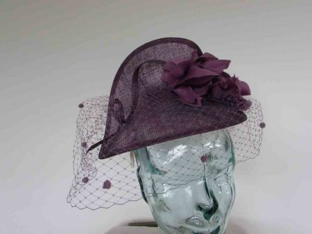 Sinamay fascinator with flower and netting in purple