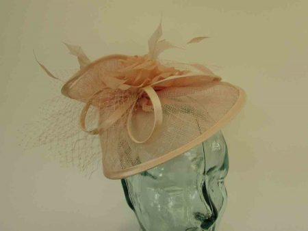 Twisted sinamay fascinator in nude
