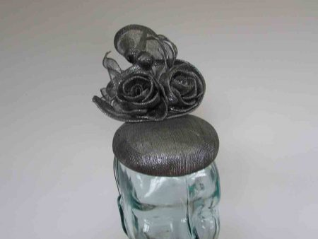 Pillbox fascinator with sinamay flower detail in granite grey