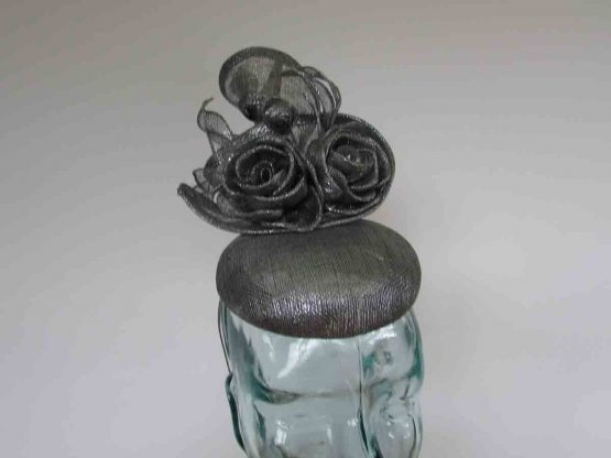 Pillbox fascinator with sinamay flower detail in granite grey