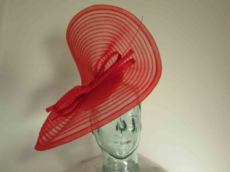 Pleated crin fascinator on a pillbox base in poppy red