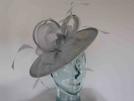 Silver hatinator with sinamay and crim bow