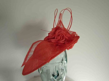 Three quarter brim hatinator with flower in coral