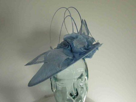 Three quarter brim hatinator with flower in powder blue