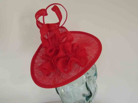 Oval hatinator with sinamay swirls in poppy red