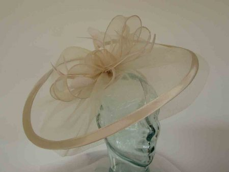 Large crin fascinator with satin trim in champagne