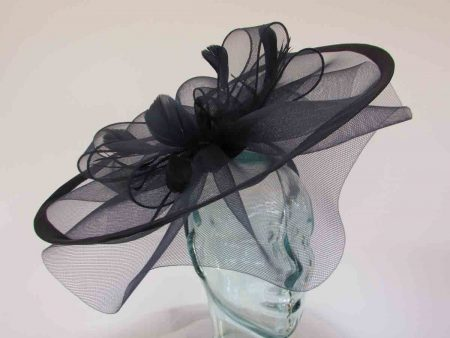 Large crin fascinator with satin trim in navy
