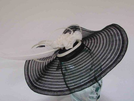 Large pleated crin fascinator in black with ivory flowers