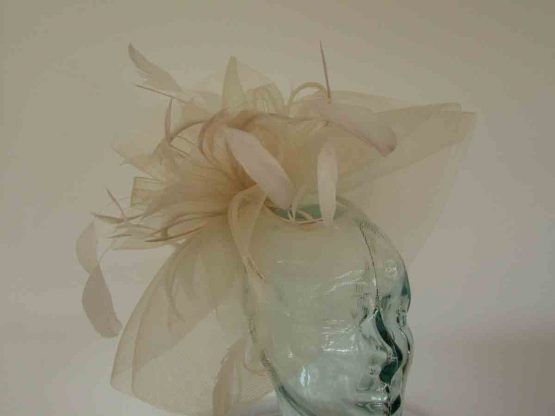 Layered crin fascinator in feathers in champagne