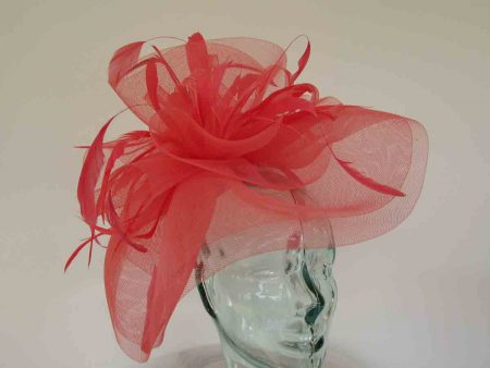 Layered crin fascinator in feathers in bright coral