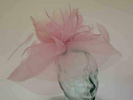Layered crin fascinator in feathers in dusky pink