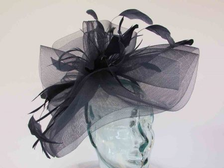 Layered crin fascinator in feathers in navy