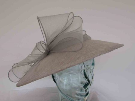 Sinamay hatinator with crin bow in silver