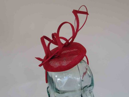 Pillbox fascinator with sinamay swirls in carmine red