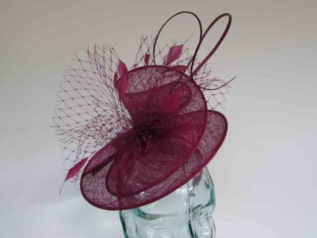 Sinamay swirl fascinator in berry