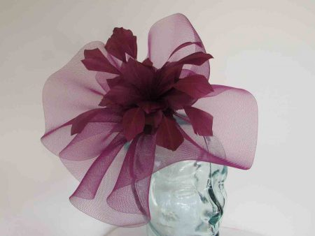 Crin fascinator with feathered flower in berry