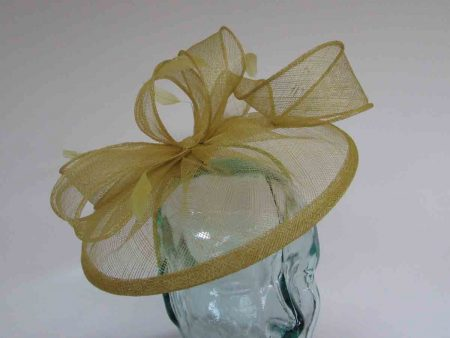 Sinamay fascinator with feathers in citrus green