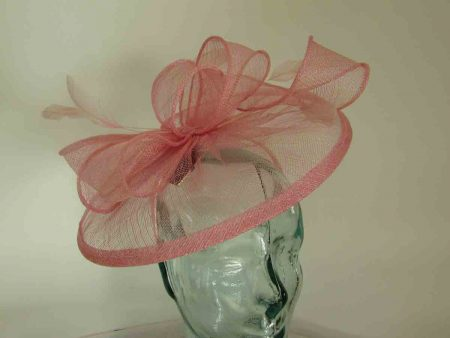 Sinamay fascinator with feathers in confetti pink