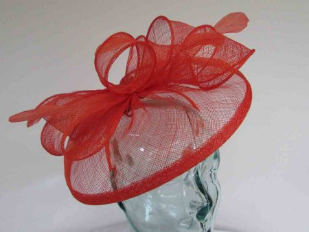 Sinamay fascinator with feathers in persimmon orange