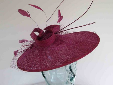 Circular hatinator with sinamay bow in berry