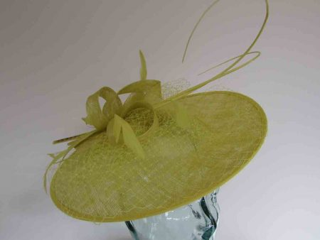 Circular hatinator with sinamay bow in citrus lime