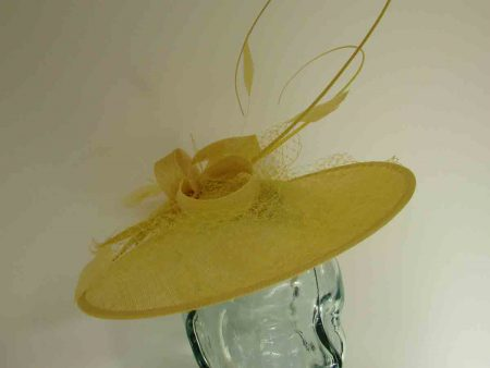 Circular hatinator with sinamay bow in daffodil yellow