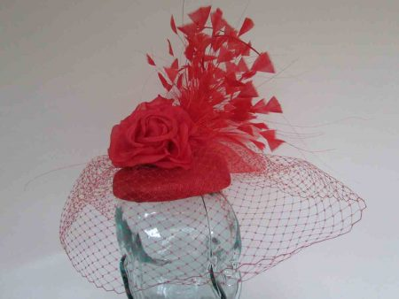 Pillbox fascinator with dramatic feathers in vermilion