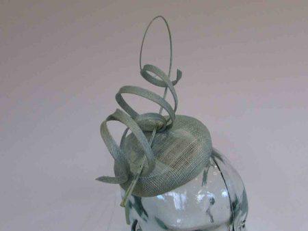 Pillbox fascinator with sinamay swirls in bermuda mint