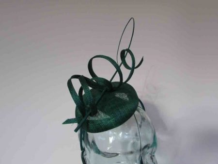 Pillbox fascinator with sinamay swirls in emerald green