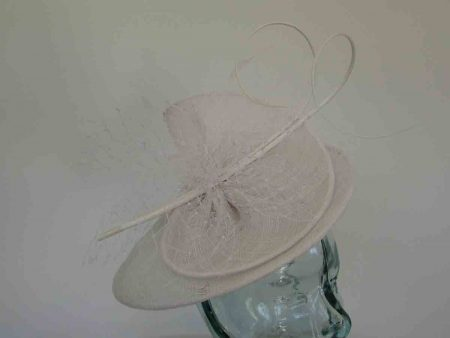 Sinamay swirl fascinator in white