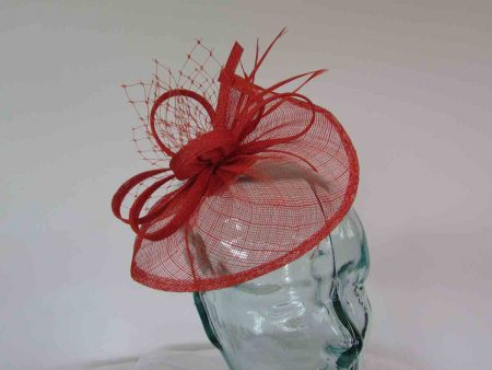 Small sinamay fascinator with netting in burnt orange
