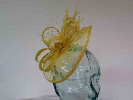 Small sinamay fascinator with netting in bright yellow