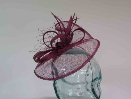 Small sinamay fascinator with netting in deep peony