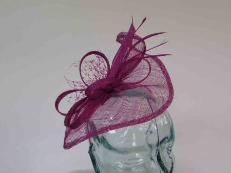 Small sinamay fascinator with netting in fuschine pink