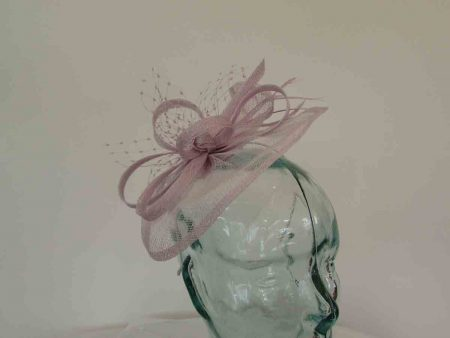 Small sinamay fascinator with netting in lilac