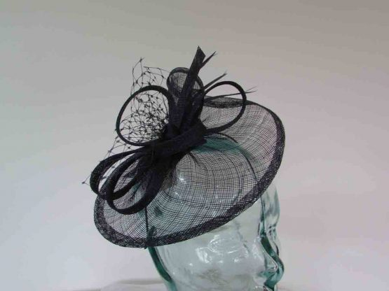 Small sinamay fascinator with netting in navy