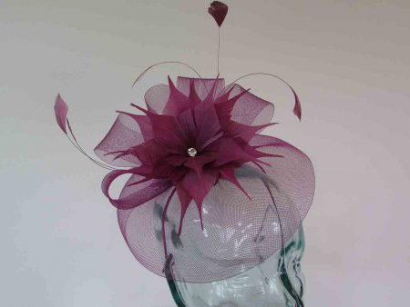 Crin fascinator with feathered flower in deep peony