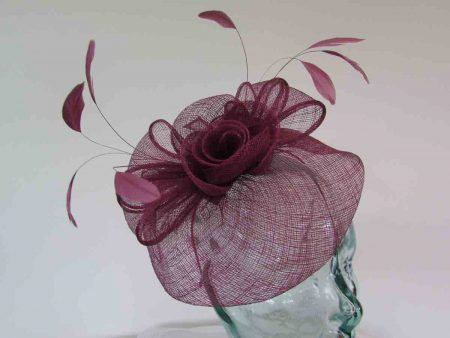 Sinamay fascinator with flower in deep peony