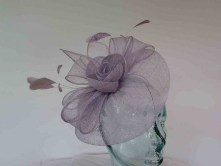 Sinamay fascinator with flower in ice lilac