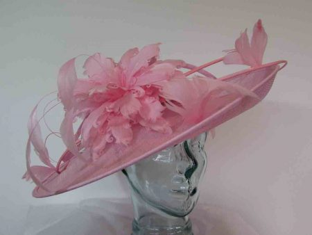 Large hatinator with feathered flower in wild rose