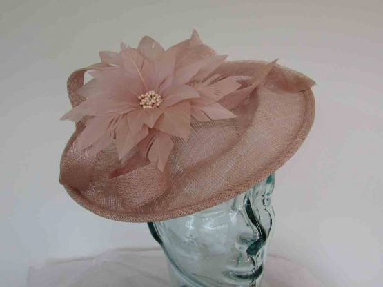 Hatinator with feathered flower and beading in blush pink