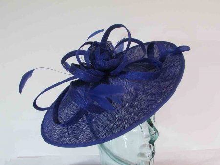 hatinator with sinamay flower and loops in  cobalt blue