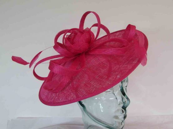 hatinator with sinamay flower and loops in hot pink